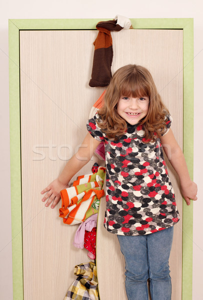 little girl trying to close the closet  Stock photo © goce