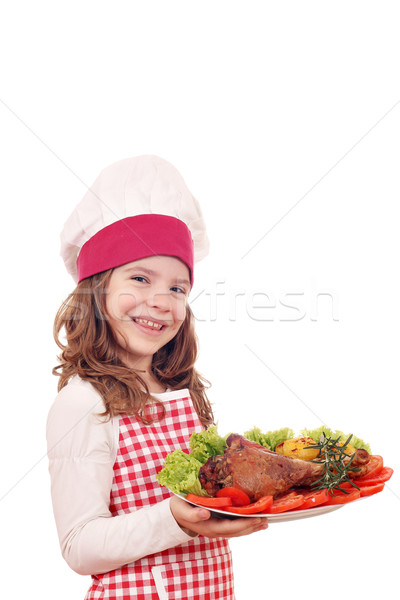 little girl cook with turkey drumstick Stock photo © goce