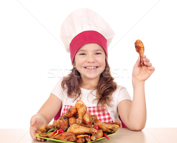 beautiful little girl cook with chicken drumstick Stock photo © goce
