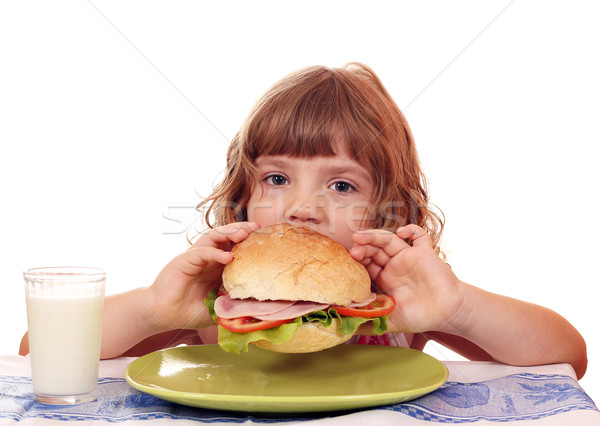 Faim petite fille manger grand sandwich alimentaire Photo stock © goce