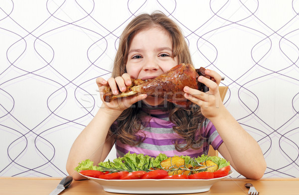 hungry little girl eating big turkey drumstick  Stock photo © goce