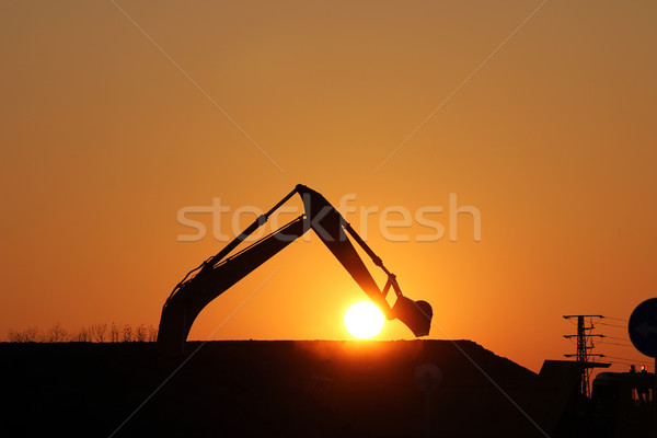 excavator on construction site silhouette Stock photo © goce