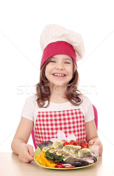 happy little girl cook with trout fish Stock photo © goce