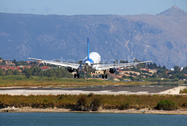 passenger airplane landing on Corfu airport Stock photo © goce