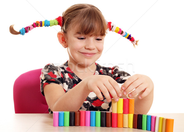 happy little girl play with plasticine Stock photo © goce
