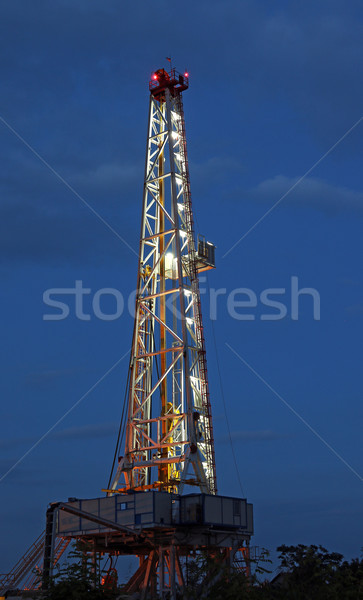 illuminated oil drilling rig on oilfield Stock photo © goce