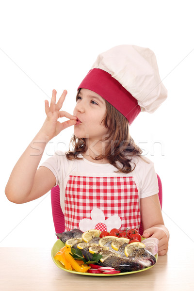 little girl cook with prepared trout on plate Stock photo © goce