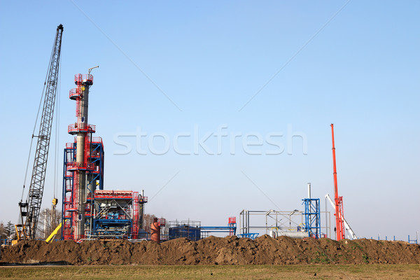 new refinery construction site with crane and machinery Stock photo © goce