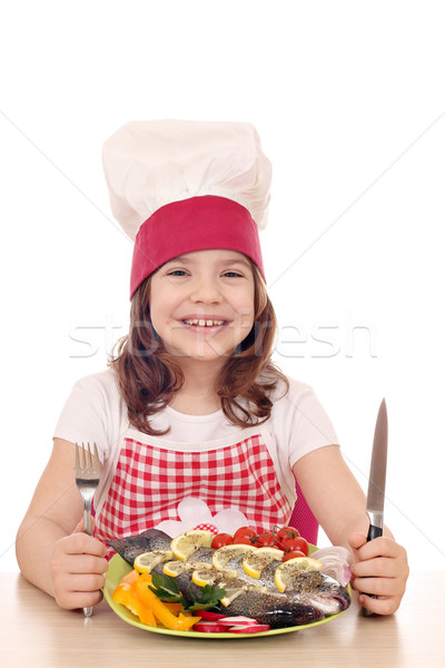 счастливым девочку Кука подготовленный рыбы готовый Сток-фото © goce