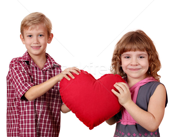 boy and little girl holding big red heart Stock photo © goce