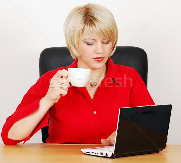 woman with coffee-cup and laptop Stock photo © goce