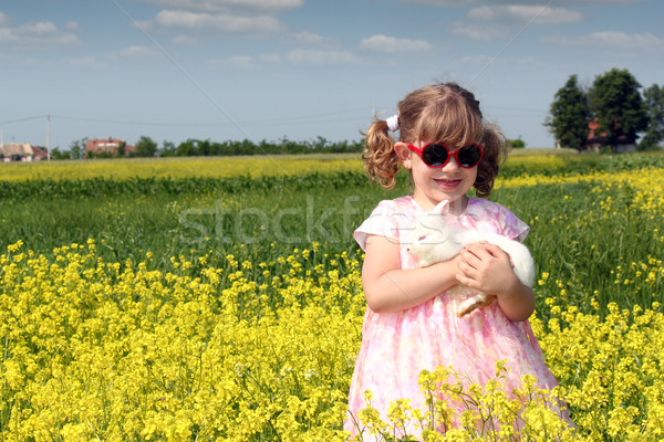 little girl with dwarf white bunny spring scene Stock photo © goce