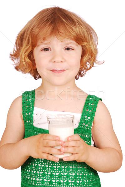 Petite fille potable lait enfant verre beauté Photo stock © goce