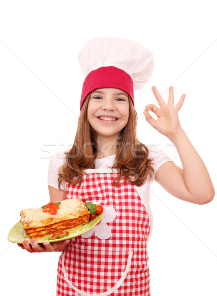 happy little girl cook with Italian lasagne and ok hand sign Stock photo © goce