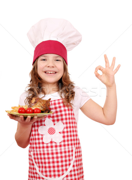 happy little girl cook with roasted chicken wings and ok hand si Stock photo © goce