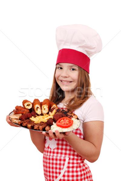 Gelukkig meisje kok gegrild vlees kind diner Stockfoto © goce