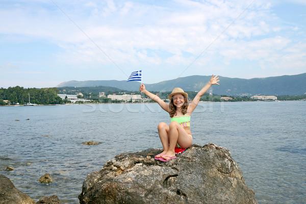 happy little girl with a Greek flag Corfu island Greece Stock photo © goce