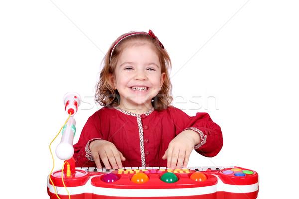 счастливым девочку играть музыку улыбка ребенка Сток-фото © goce