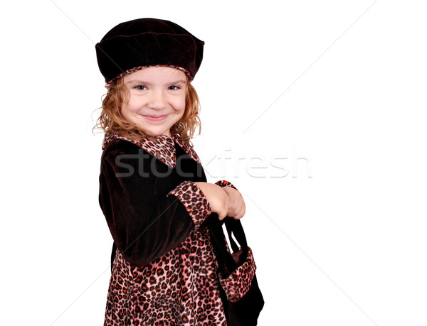 Stock photo: little girl in a dress with a leopard design