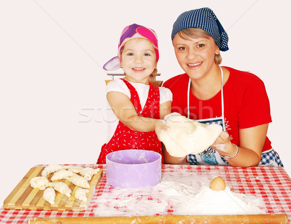 mother and daughter make croissants Stock photo © goce