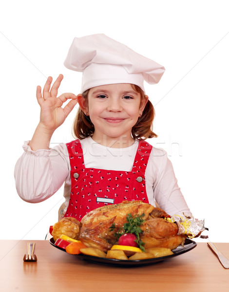beautiful little girl cook with grilled chicken Stock photo © goce