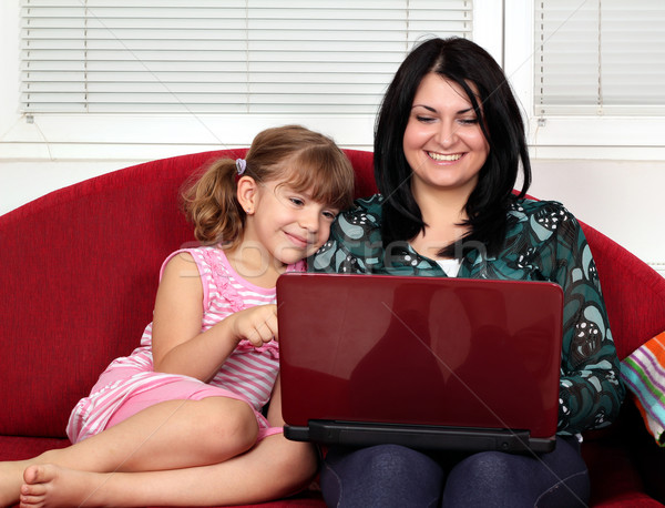 little girl and woman with laptop Stock photo © goce