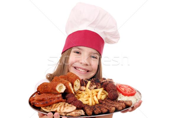 Küçük kız pişirmek ızgara plaka mutlu çocuk Stok fotoğraf © goce