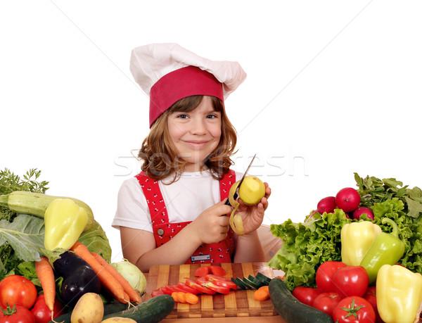 little girl cook peeling potatoes  Stock photo © goce