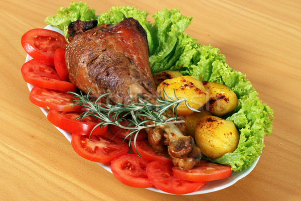 turkey drumstick with vegetables on plate  Stock photo © goce