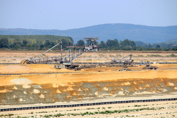 Giant excavator digging coal on open pit coal mine Stock photo © goce