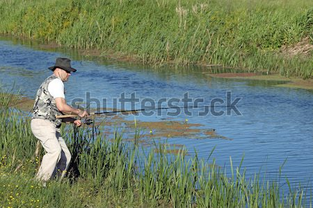 hunter aiming and ready for shot wild duck hunting Stock photo © goce