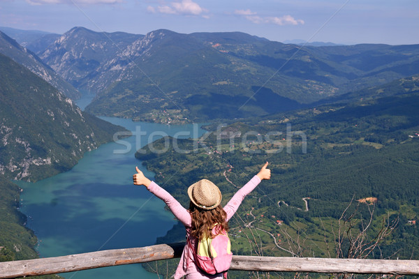 little girl hiker with thumbs up on mountain Stock photo © goce