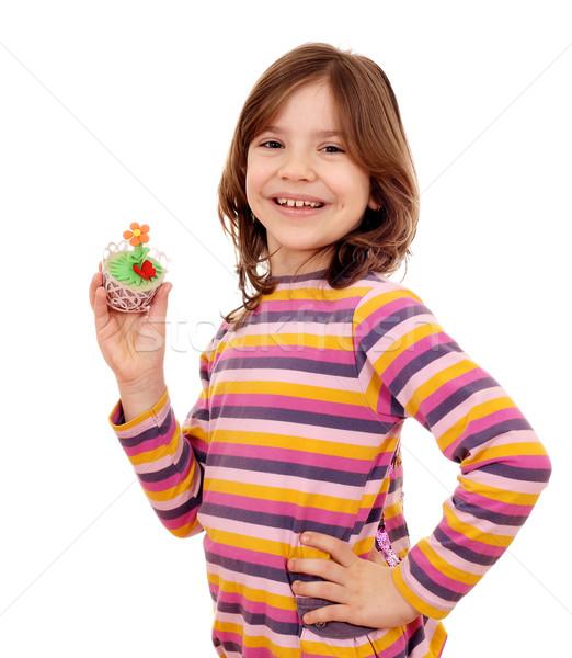 happy little girl holding spring flower muffin Stock photo © goce