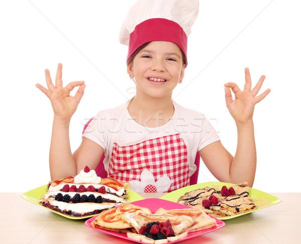 Boldog kislány szakács finom asztal ok Stock fotó © goce