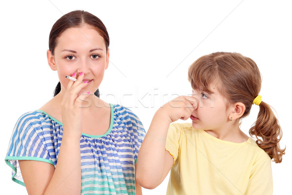 little girl bothered by tobacco smoke  Stock photo © goce