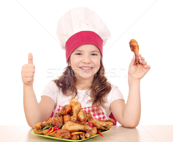 happy little girl cook with chicken drumstick and thumb up Stock photo © goce