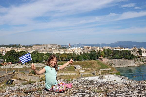 Kislány görög zászló hüvelykujj felfelé város Stock fotó © goce