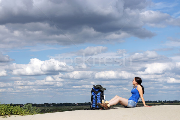 girl hiker sitting on the sand and rest  Stock photo © goce