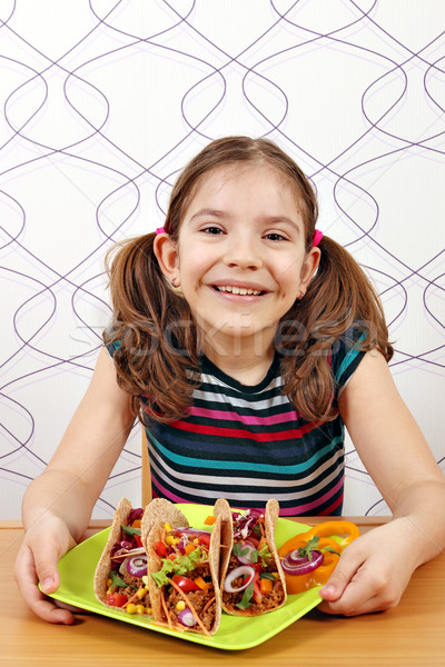 Boldog kislány taco étel mosoly gyermek Stock fotó © goce