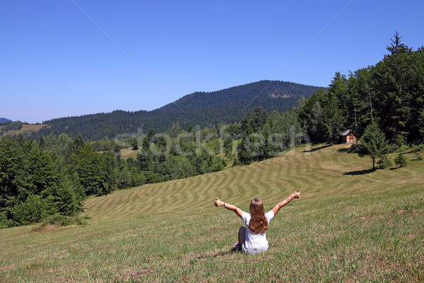little girl with thumbs up is sitting in the meadow Tara mountai Stock photo © goce