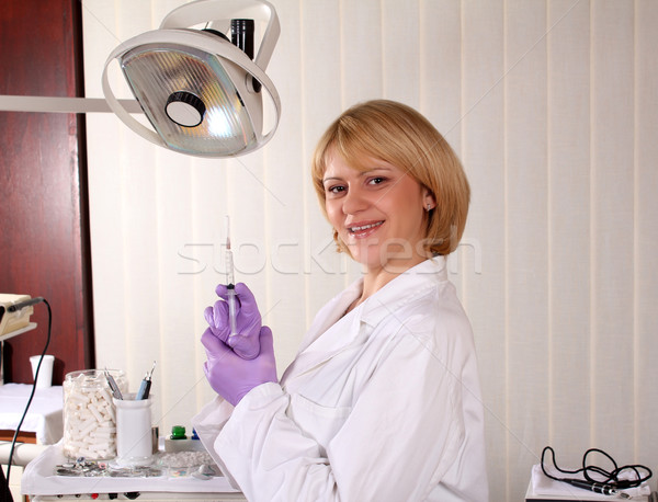 happy female dentist with equipment Stock photo © goce