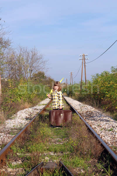 little girl with suitcase and umbrella standing on railroad Stock photo © goce