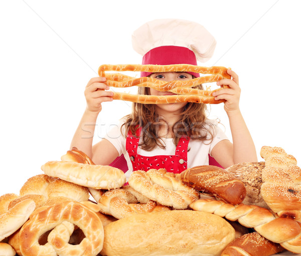 little girl cook with breads pretzels and buns Stock photo © goce
