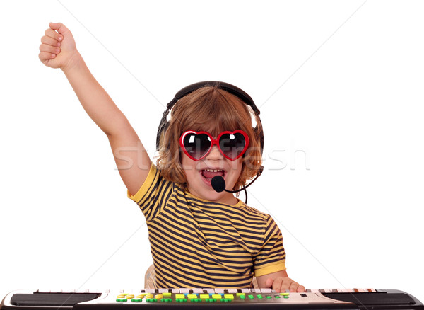 happy little girl play keyboard and sing Stock photo © goce
