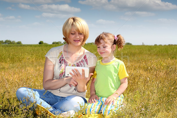 mother and daughter playing with tablet Stock photo © goce