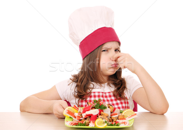 little girl cook with seafood bad smell Stock photo © goce