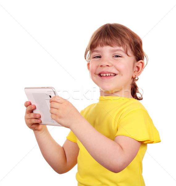 happy little girl holding tablet pc Stock photo © goce