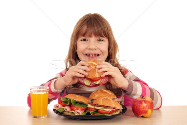 happy little girl eating sandwich  Stock photo © goce