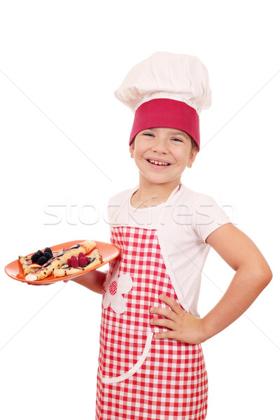 happy little girl cook with delicious crepes Stock photo © goce