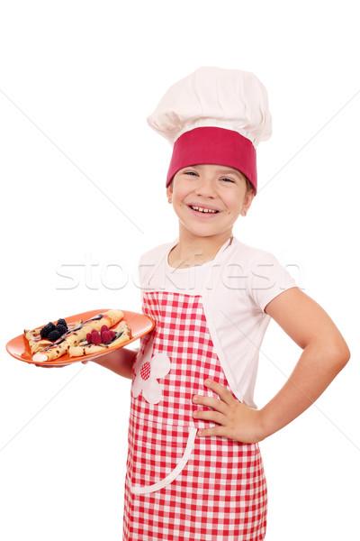 Boldog kislány szakács finom mosoly gyermek Stock fotó © goce